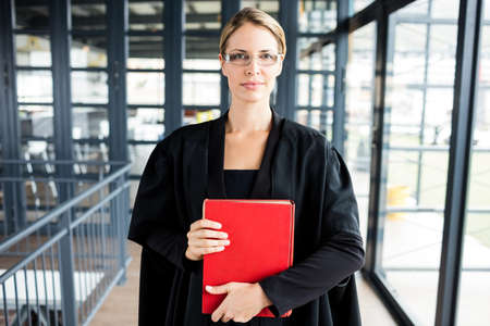 female lawyer: Female lawyer wears glasses and looking at the camera in her firm