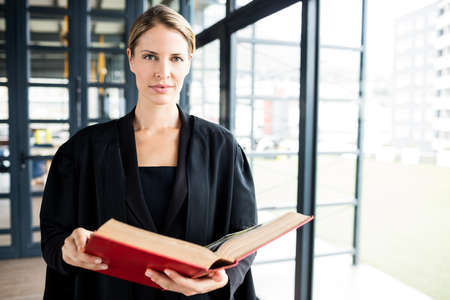 female lawyer: Female lawyer reading a book attentively in a building