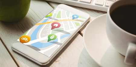 representations: Navigation pointers with various representations on map against smartphone on desk
