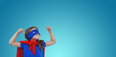 pretending: Masked girl pretending to be superhero against purple vignette Stock Photo
