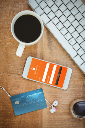 digitally generated image: Digitally generated image of world credit card against coffee and white smartphone with headphones