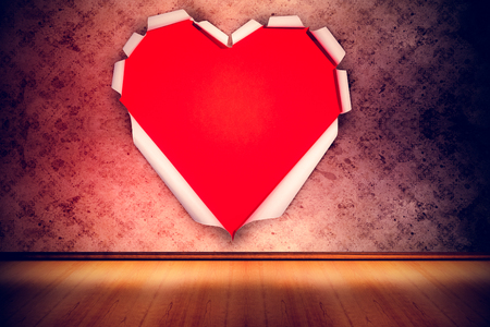 grimy: White paper cut in heart shape against grimy room