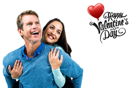 carrying girlfriend: Man carrying girlfriend on back against cute valentines message Stock Photo