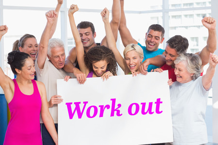 work out: The word work out and excited people holding blank billboard at gym against white angular design Stock Photo