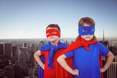 pretending: Masked kids pretending to be superheroes against new york skyline