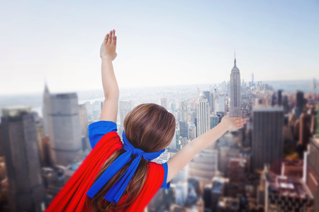 pretending: Masked girl pretending to be superhero against new york skyline Stock Photo