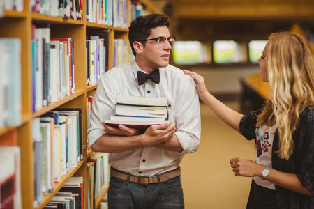 man studying: Embarrassed nerd meeting up a girl in library