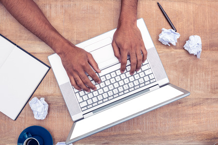 office physical pressure paper: Directly shot of stressed businessman using laptop at desk in office Stock Photo