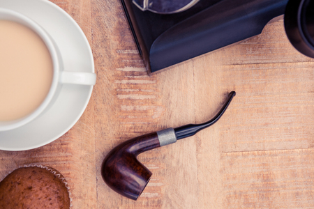 bad habit: Close-up of coffee and smoking pipe on table