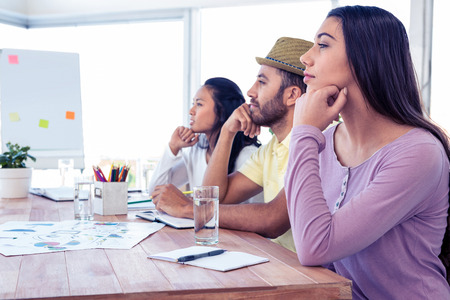 day dreaming: Colleagues day dreaming while sitting in conference room at creative office