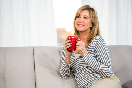 day dreaming: Woman day dreaming holding a cup
