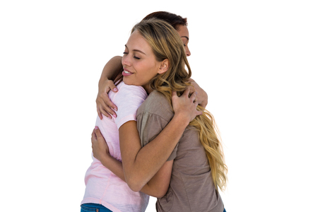 light hair: Two girls hugging and smiling Stock Photo