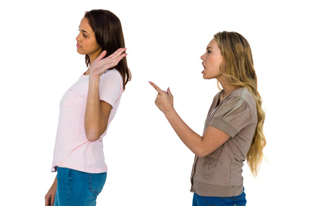 ignoring: Two girls arguing pointing a finger and ignoring