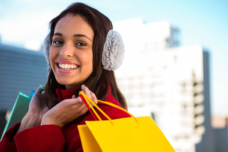 stylish hair: Smiling women holding shopping bags outside Stock Photo