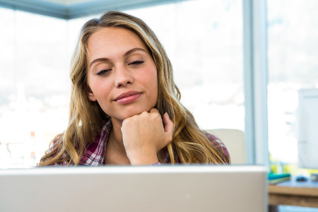 uses: Young girl uses his computer in an office Stock Photo