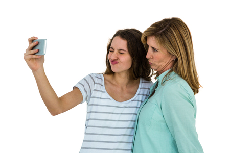 Mother and daughter make a selfie with a smartphone Stock Photo