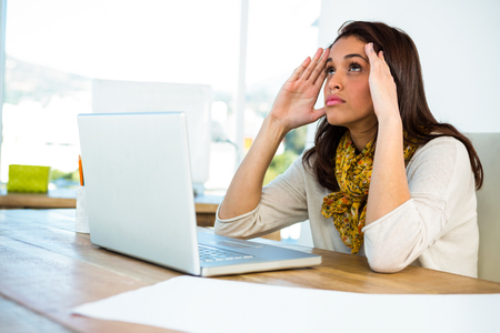 uses a computer: Young girl uses his computer in an office Stock Photo