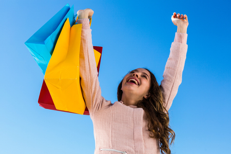 after shopping: Happy young girl after shopping in a sunny day Stock Photo
