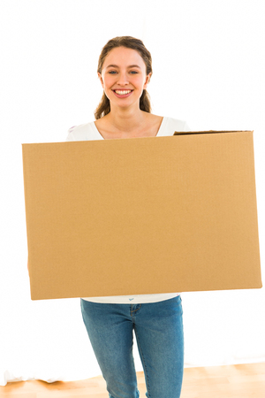 moving house: girl holding a box smiling Stock Photo