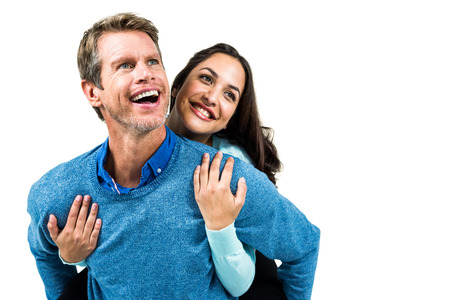 carrying girlfriend: Cheerful man carrying girlfriend on back against white background