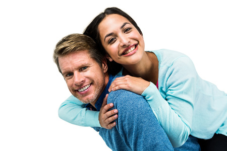 carrying girlfriend: Portrait of cheerful man carrying girlfriend on back against white background