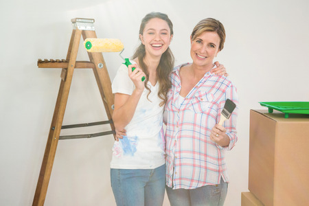 redecorating: Mother and daughter redecorating a room together