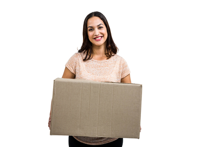 carboard box: Portrait of cheerful woman with carboard box against white background Stock Photo