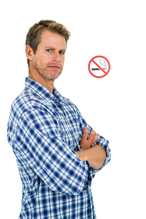 crossed cigarette: Portrait of serious man with no smoking sign over white background