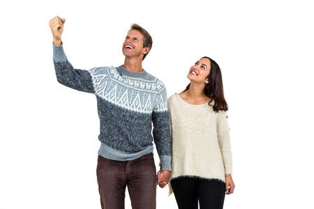 personas mirando: hombre de �xito con su novia de pie contra el fondo blanco