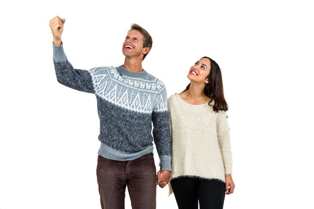 man holding woman: Successful man with girlfriend standing against white background