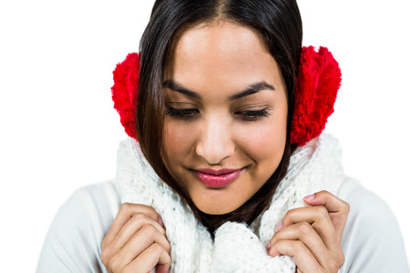 muff: Close-up of woman wearing ear muff against white background