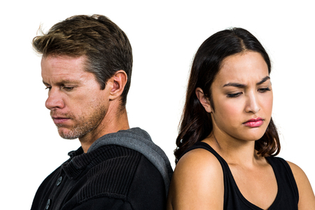 bleakness: Upset couple standing back to back against white background Stock Photo