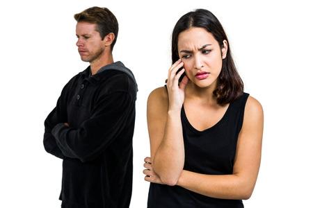 desolaci�n: Depressed couple standing back to back against white background Foto de archivo