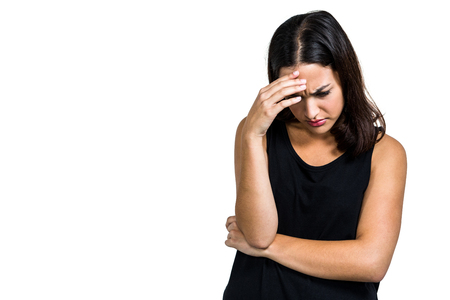 dreariness: Depressed woman with hand on head against white background