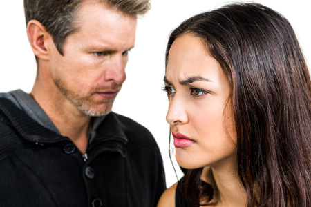 not talking: Couple not talking after argument on white background