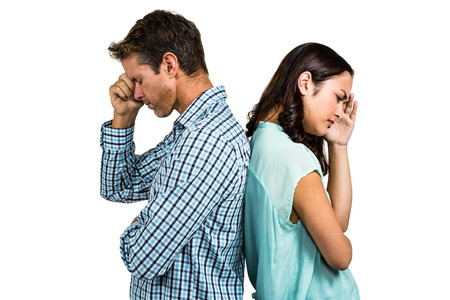 outraged: Depressed couple standing back to back against white background Stock Photo
