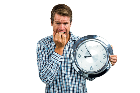 late 40s: Anxious late man holding a clock on white background Stock Photo