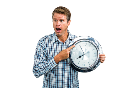late 40s: Casual late man showing a clock on white background