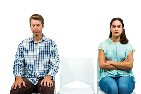 not talking: Sad couple not talking after argument on white background