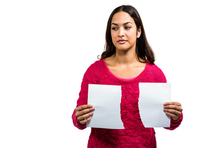 strife: Woman holding torn documents while standing on white background