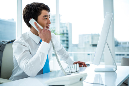 phone professional: Businessman making a phone call in an office
