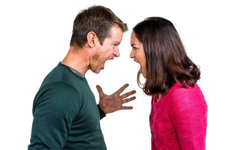 mixed couple: Side view of couple fighting against white background Stock Photo
