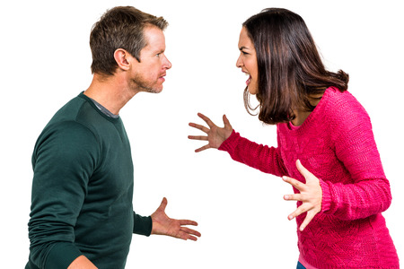 Couple fighting against white background