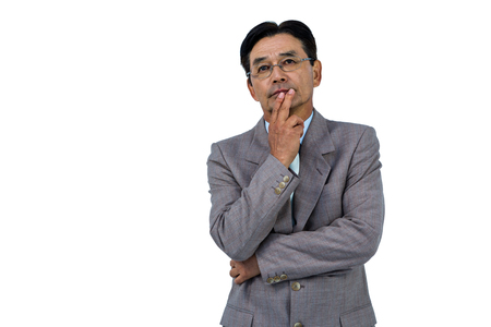 hand on the chin: Businessman with hand on chin on white background