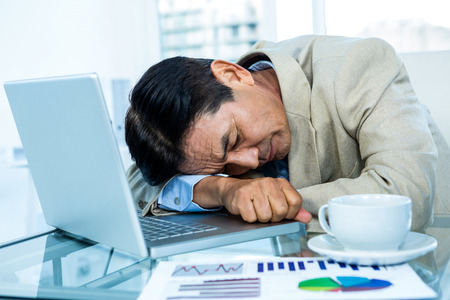 asian businessman: Tired asian businessman sleeping in office Stock Photo