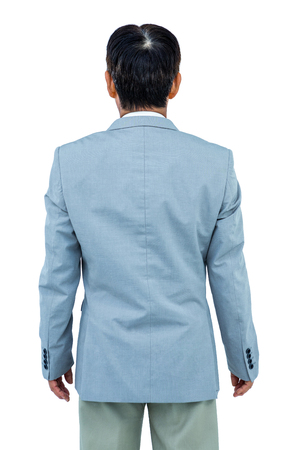turned: A back turned businessman on white background