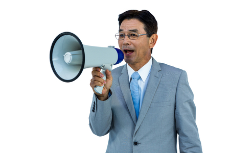 withe: Asian businessman talking through megaphone on withe background