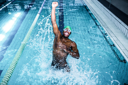 sports race: Fit man diving in the swimming pool at the leisure centre