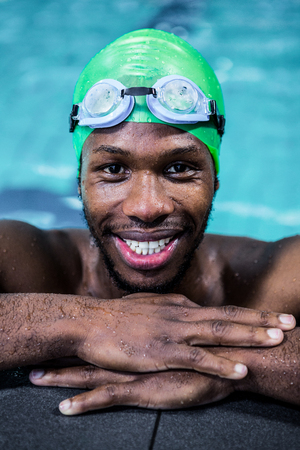 leisure centre: Smiling fit man in the swimming pool at the leisure centre