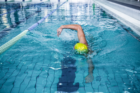 lane marker: Fit man swimming with swimming hat in swimming pool